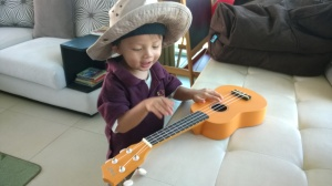 Singing with the ukulele in his uniform